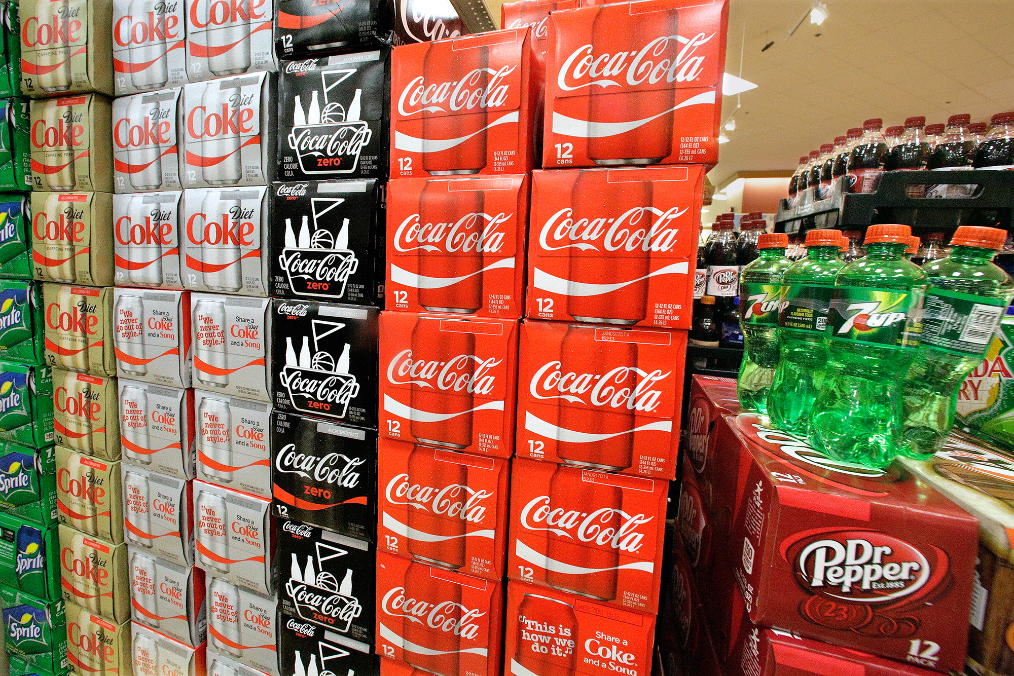 Sodas and energy drinks are stacked and line the shelves of a grocery store. Seth Perlman/AP