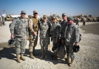 The Gray Team with Maj. Jennifer Bell (center), who ran a concussion clinic, seen in the Helmand province of Afghanistan in 2010: Col. Michael Jaffee (from left) , Capt. James Hancock, Col. Geoffrey Ling, Lt. Col. Shean Phelps and Col. Robert Saum. Courtesy of Christian Macedonia