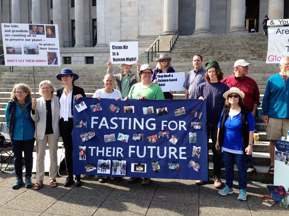 A group that is fasting as part of a protest against Gov. Jay Inslee's Clean Air Rule to cap carbon emissions says the proposed rule doesn't go far enough. (Photo by Austin Jenkins/Northwest News Network)