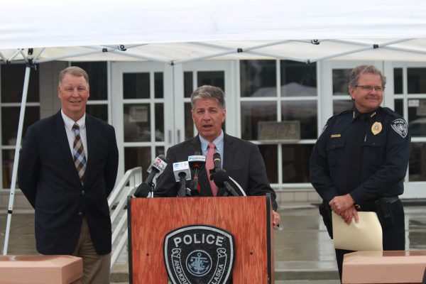Anchorage Mayor Ethan Berkowitz (at podium), Commissioner Marc Luiken (left) and Police Chief Chris Tolley announce the launch of a new DUI patrol. (Photo by Wesley Early/Alaska Public Media)