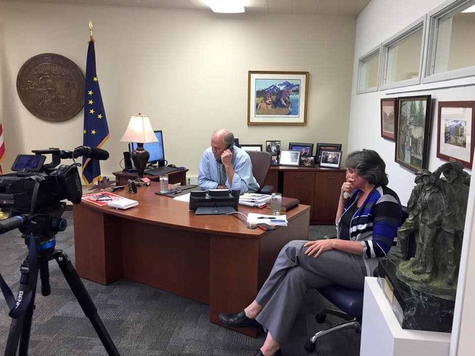 Alaska Gov. Bill Walker teleconferences into the Anchorage Assembly meeting from his temporary office in Juneau, July 13, 2016. He discussed the fiscal impact of state budgeting on the local government. (Photo courtesy Alaska Governor's Office)