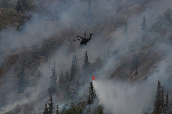 A helicopter dumps water to fight the McHugh fire on July 20, 2016. (Photo by Wesley Early/Alaska Public Media)