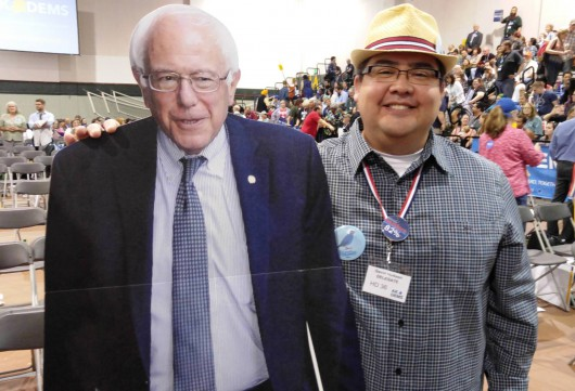 Gavin Hudson stands with a Bernie Sanders cardboard cutout during the Alaska Democratic Convention earlier this year. Hudson is headed to the Democratic National Convention in Philadelphia next week. (Photo courtesy Gavin Hudson)