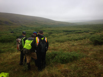 Members of the final day's search crew for missing hiker Joseph Balderas review a map of the area in Nome in July 2016. (Photo: by Emily Russell/KNOM)