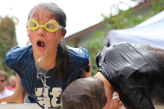 Esther Burdick comes up empty in the Bobbing-for-Fish Heads event during the 2015 festival. She would eventually land her humpy. (KCAW photo/Robert Woolsey).