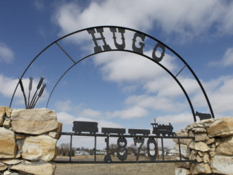 An old city sign sits on the edge of Hugo, Colo., in 2011. Officials have lifted an advisory it had instituted after tests revealed the presence of THC in the town's water supply. Further tests have turned out negative. Ed Andrieski/AP