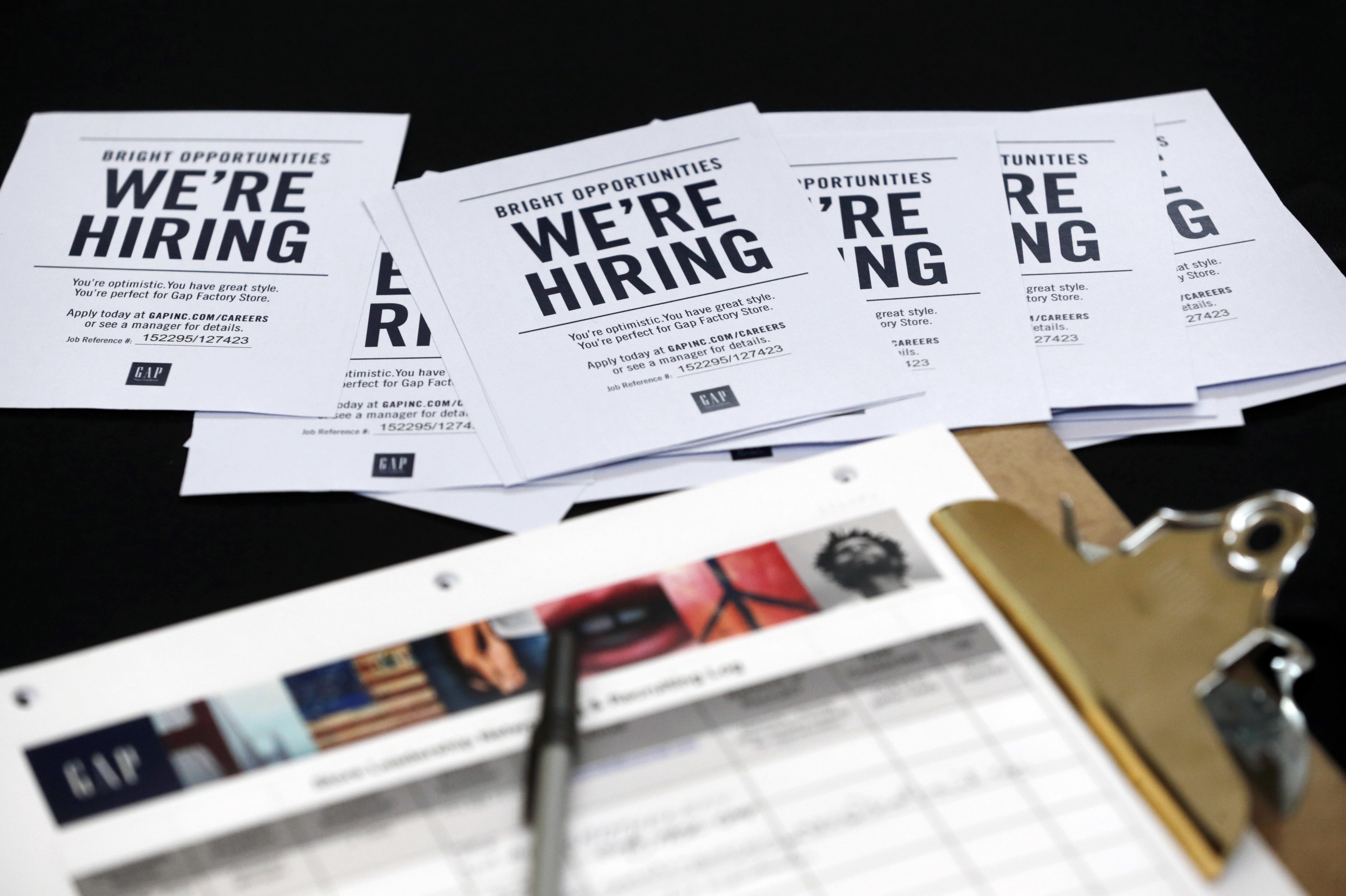 Job applications and information for the Gap Factory Store sit on a table during an October job fair at Dolphin Mall in Miami. (Photo by Wilfredo Lee/AP)