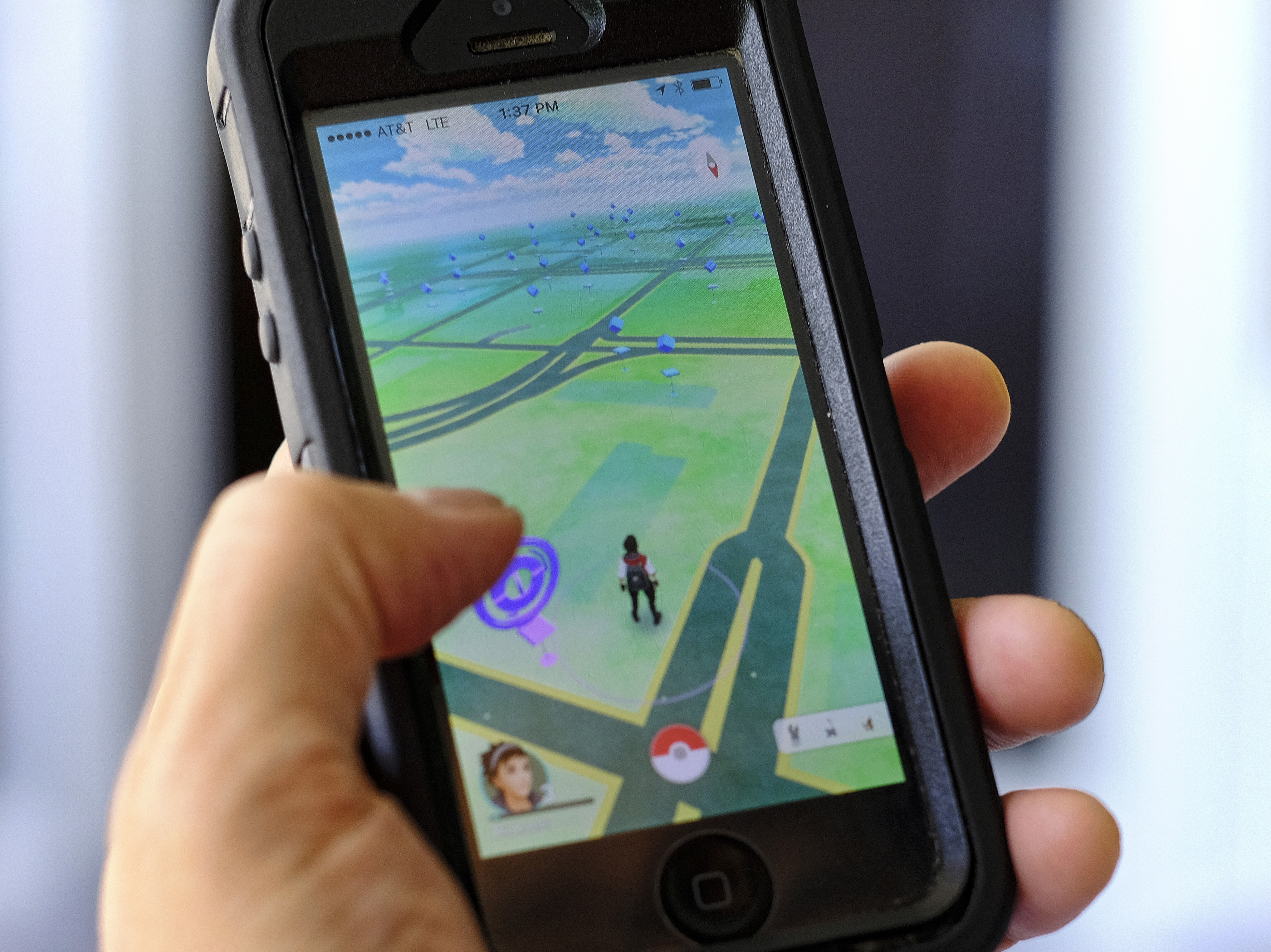 The Pokémon Go mobile game is the top-grossing app for Android and iPhone. Today, the U.S. Holocaust Museum and Arlington National Cemetery asked people to refrain from using the game while visiting the somber sites. (Photo by Richard Vogel/AP)