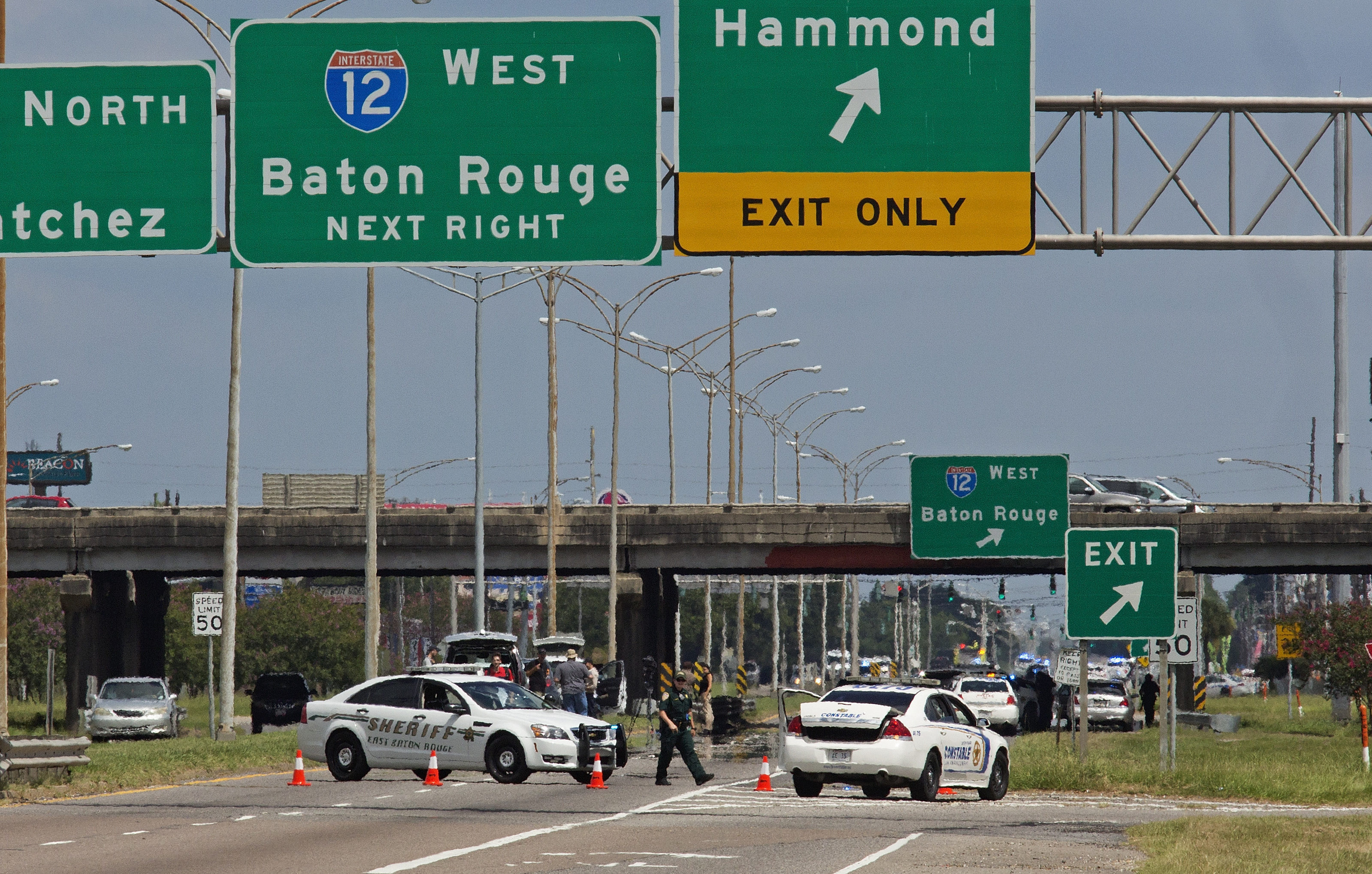 Baton Rouge police block Airline Highway after police were shot in Baton Rouge, La., Sunday, July 17, 2016. Authorities in Louisiana say several law enforcement officers are dead, and several injured in Baton Rouge after on-duty law enforcement officers were shot on Sunday morning. Max Becherer/AP