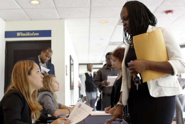 Claudia Caballero, a district manager for Aldi, talks with applicant Manoushka Metellus (right) at a job fair in Florida earlier this month. With a low unemployment rate, consumers are still spending but business inventories fell during the second quarter. Lynne Sladky/AP