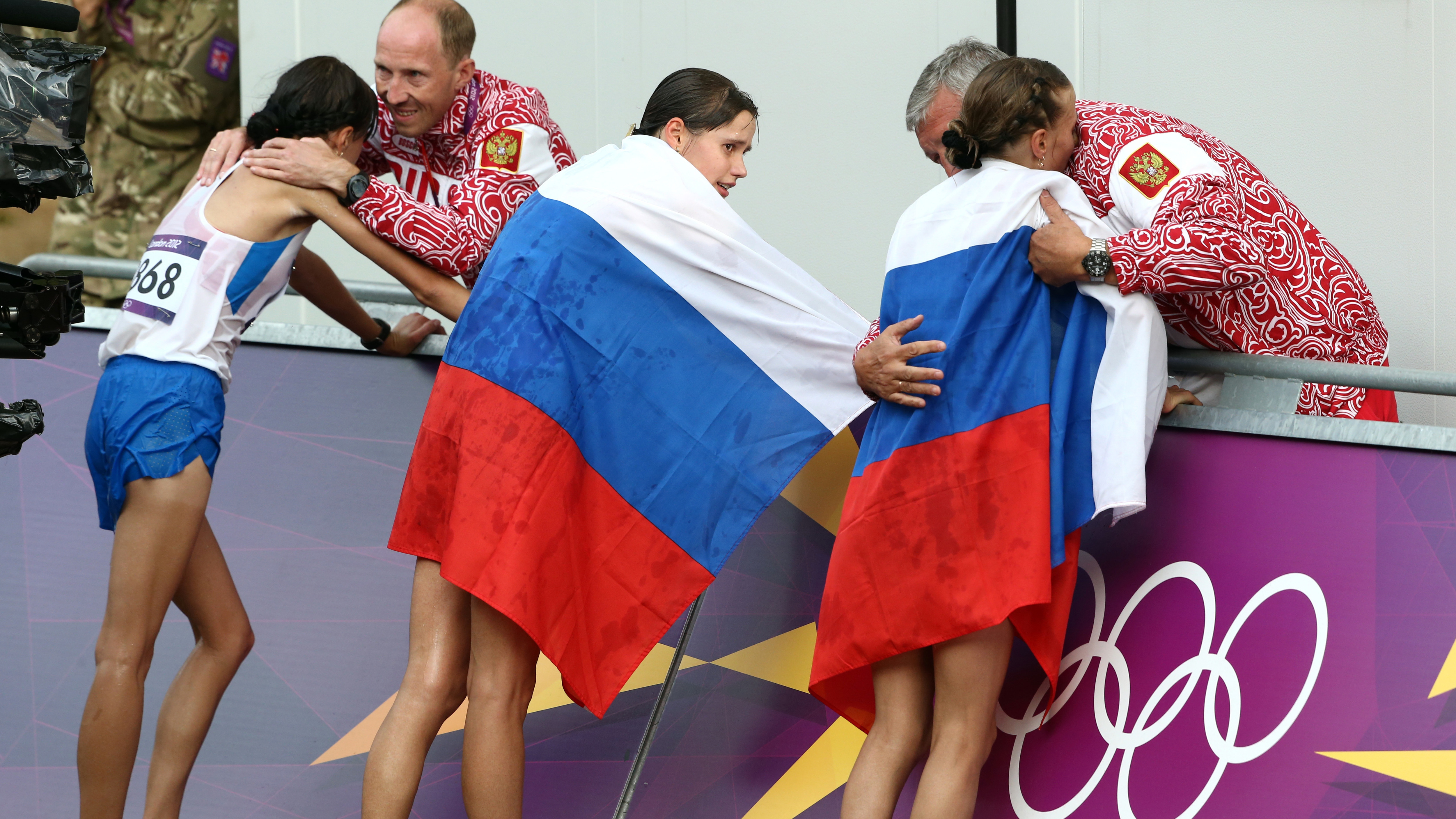 The fate of Russia's athletes for this summer's Olympics is cast further into doubt by a new setback. Here, Russian coaches and athletes are seen at the 2012 Summer Olympics in London. (Sergei Grits/AP)
