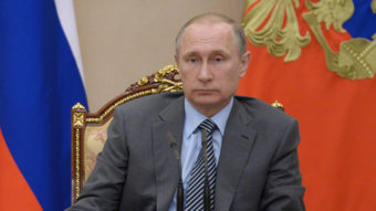 Russian President Vladimir Putin chairs a recent meeting of Russia's Cabinet in the Kremlin. Security experts say Russia is behind the DNC hack. (Photo by The Associated Press)