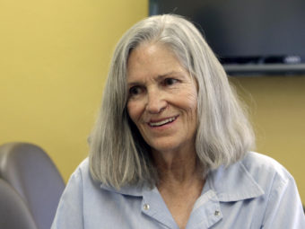 Former Charles Manson follower Leslie Van Houten confers with her attorney, Rich Pfeiffer, not shown, during a break from her hearing before the California Board of Parole Hearings in April in Chino, Calif. Nick Ut/AP