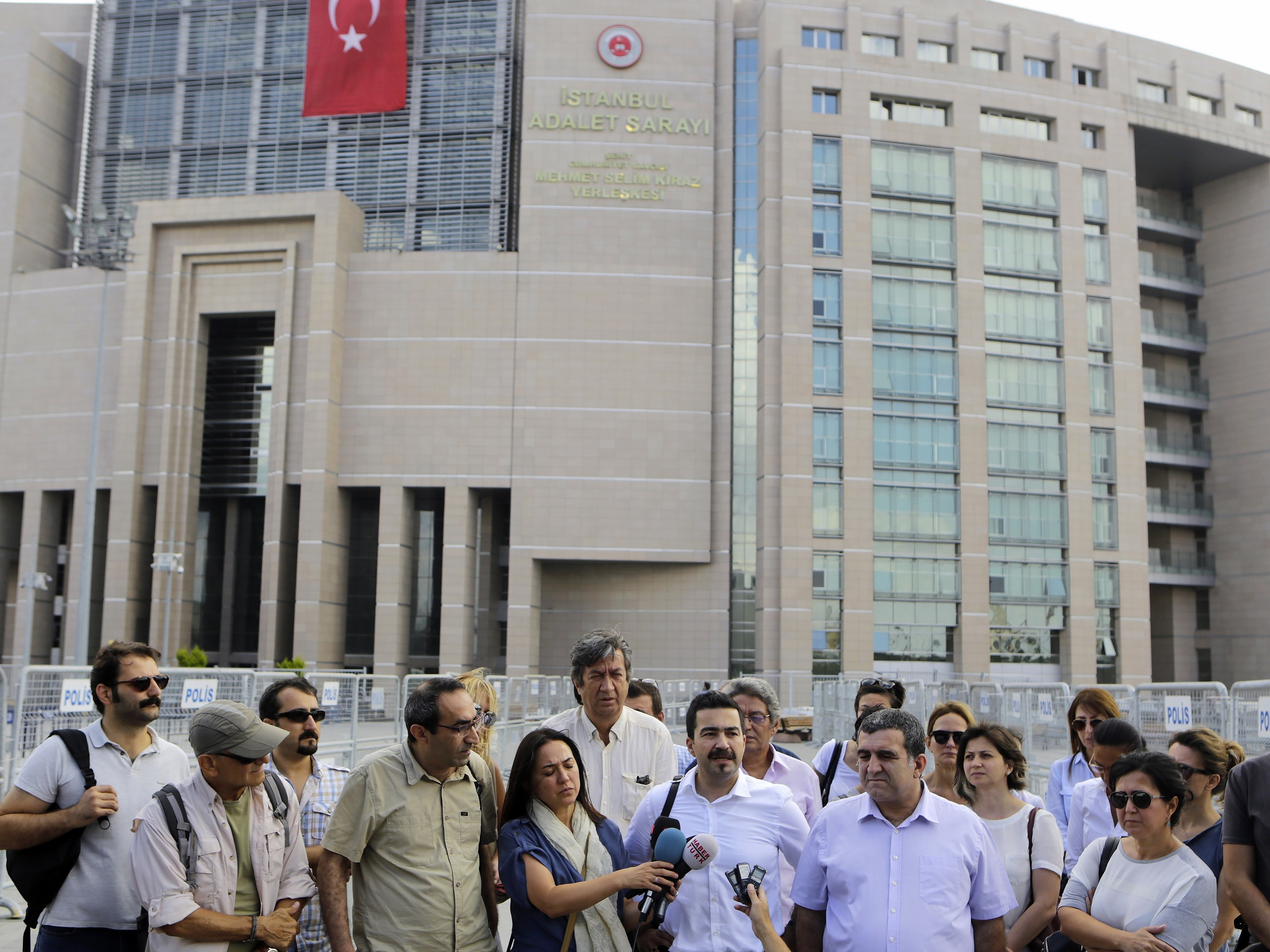 Journalists gather outside a court building to support journalist Bulent Mumay, who was detained Tuesday in connection with the investigation of the attempted coup in Turkey. (Photo by Petros Karadjias/AP)