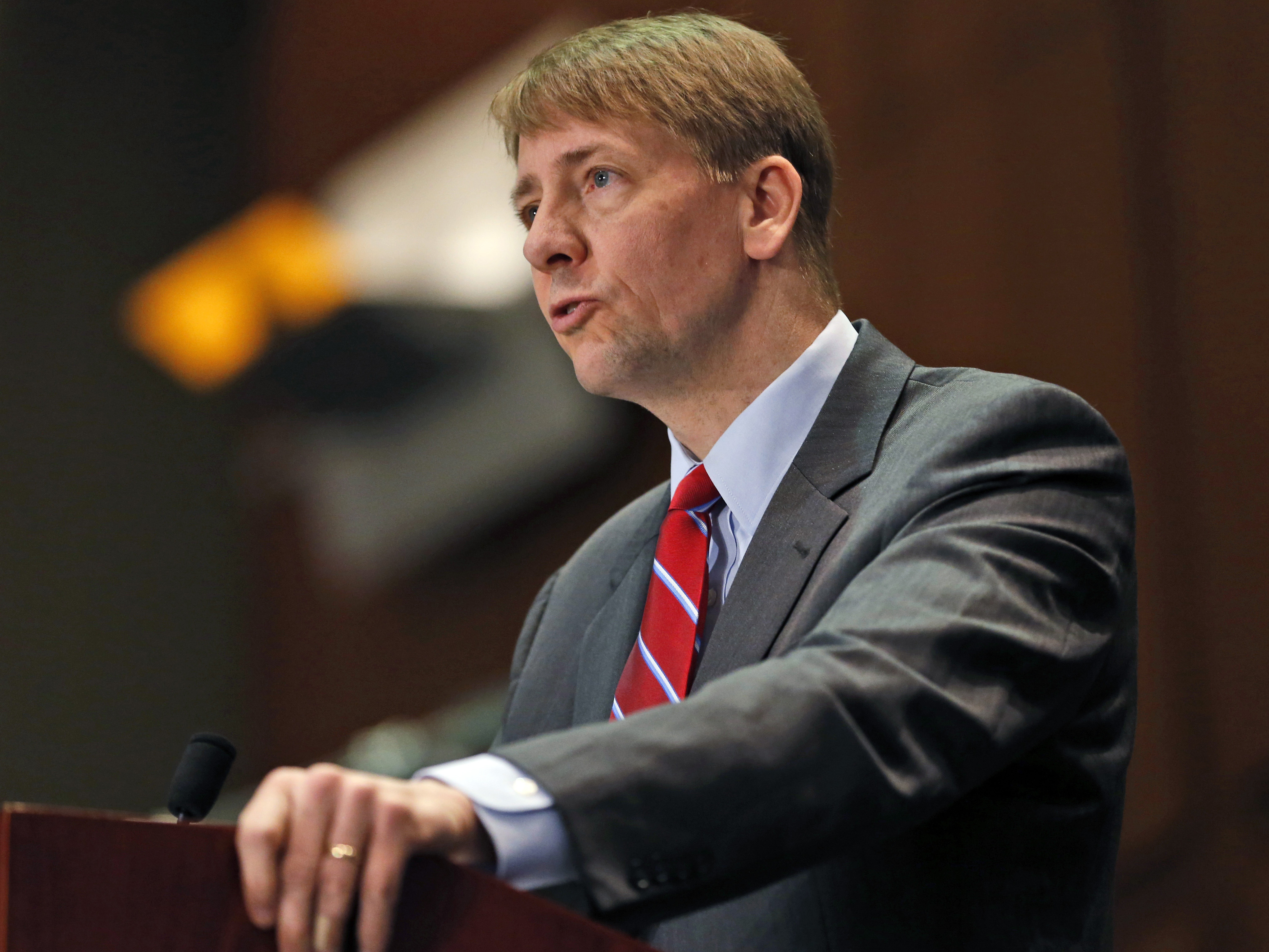 Richard Cordray, shown here at a March 2015 hearing, directs the Consumer Financial Protection Bureau, which has proposed new rules to overhaul the multi-billion dollar debt collection industry. (Photo by Steve Helber/AP)