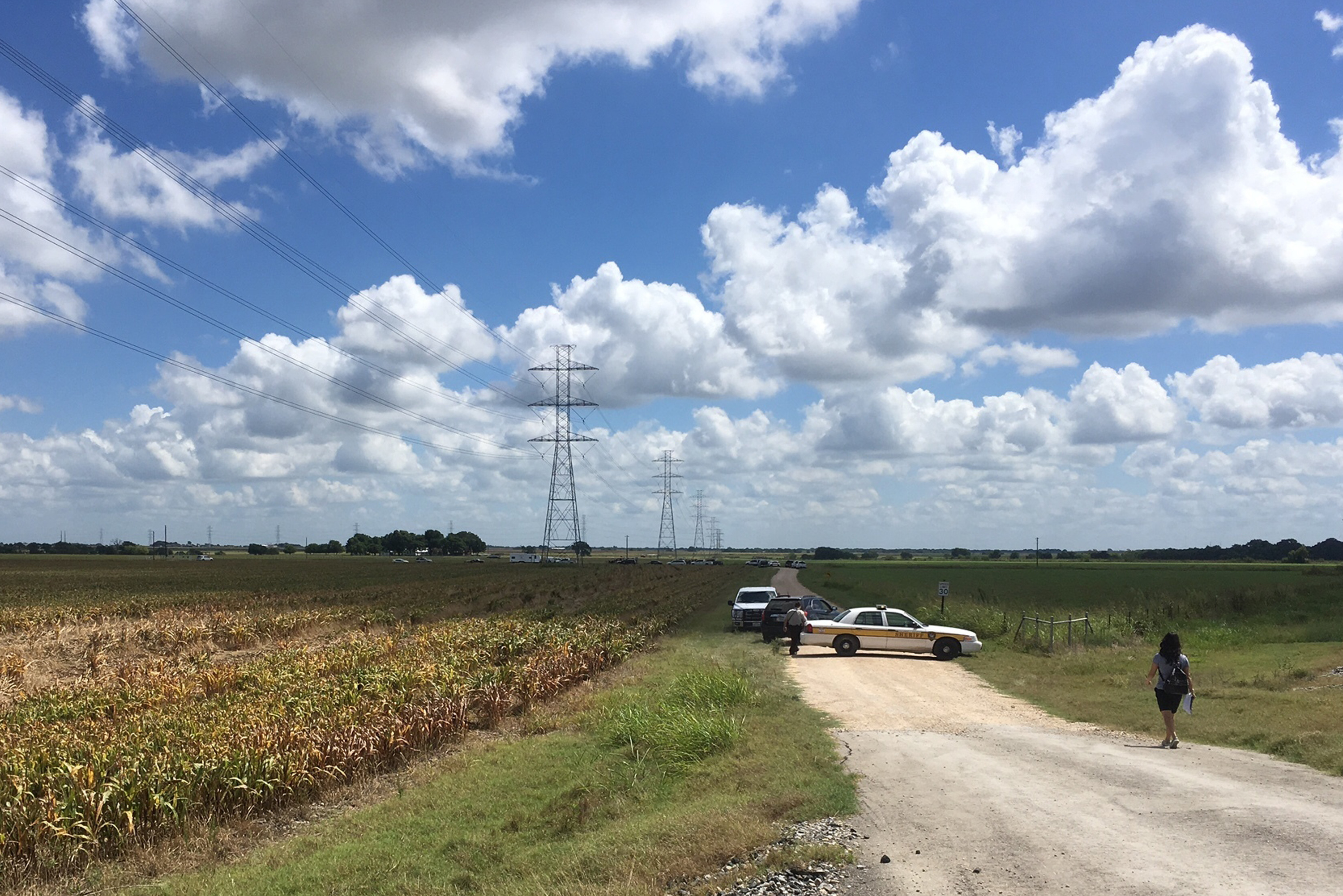 Police cars block access to the site where a hot air balloon crashed early Saturday in Central Texas. James Vertuno/AP