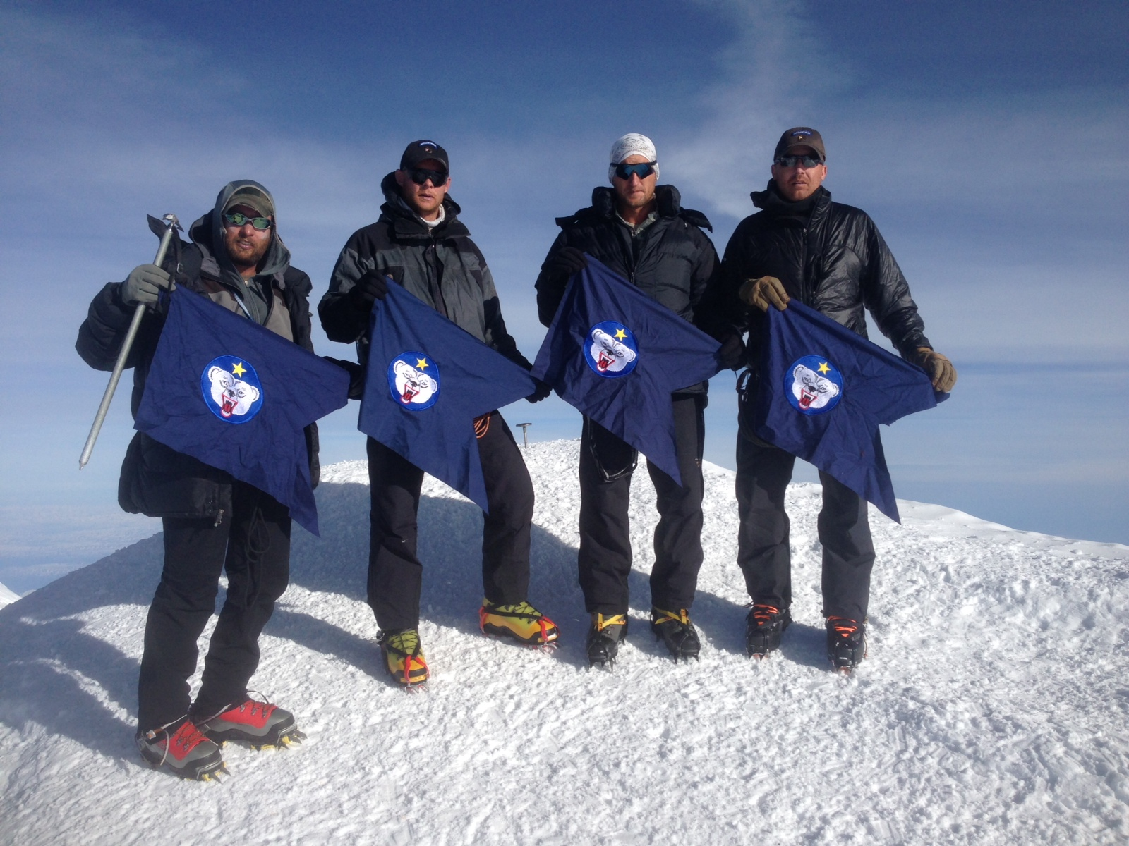 Members of a team of U. S. Army Alaska Soldiers and a civilian adviser pose for a photo on the summit of Denali (then-Mt. McKinley), the highest peak in North America on June 1, 2013. (Creative Commons photo by U.S. Army Alaska (USARAK))