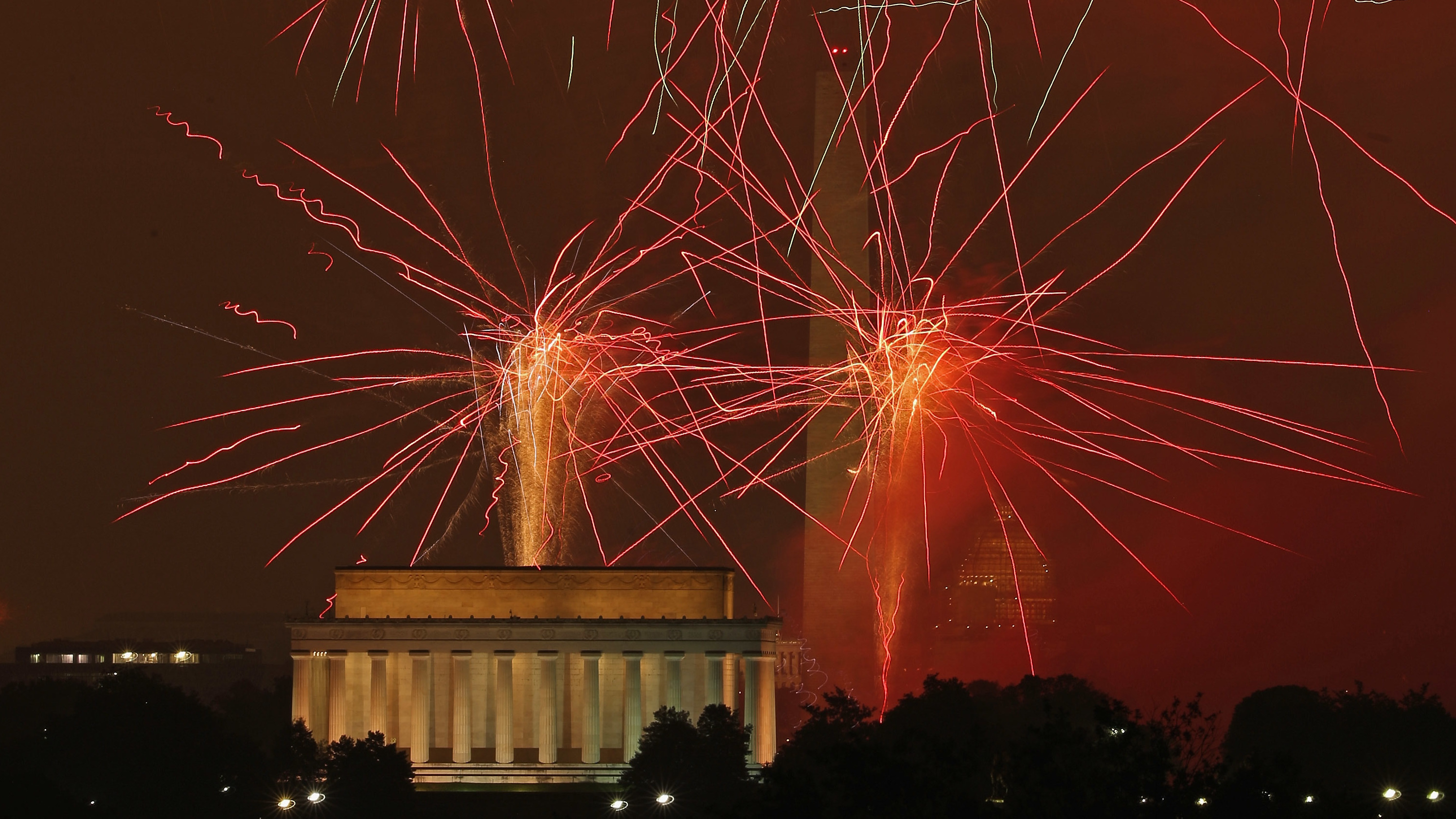 Fireworks explode over the National Mall during the 2015 July 4th fireworks show in Washington, D.C. For its 2016 Independence Day show, PBS used stock footage from previous shows, due to bad weather in the capital. (Photo by Chip Somodevilla/Getty Images)