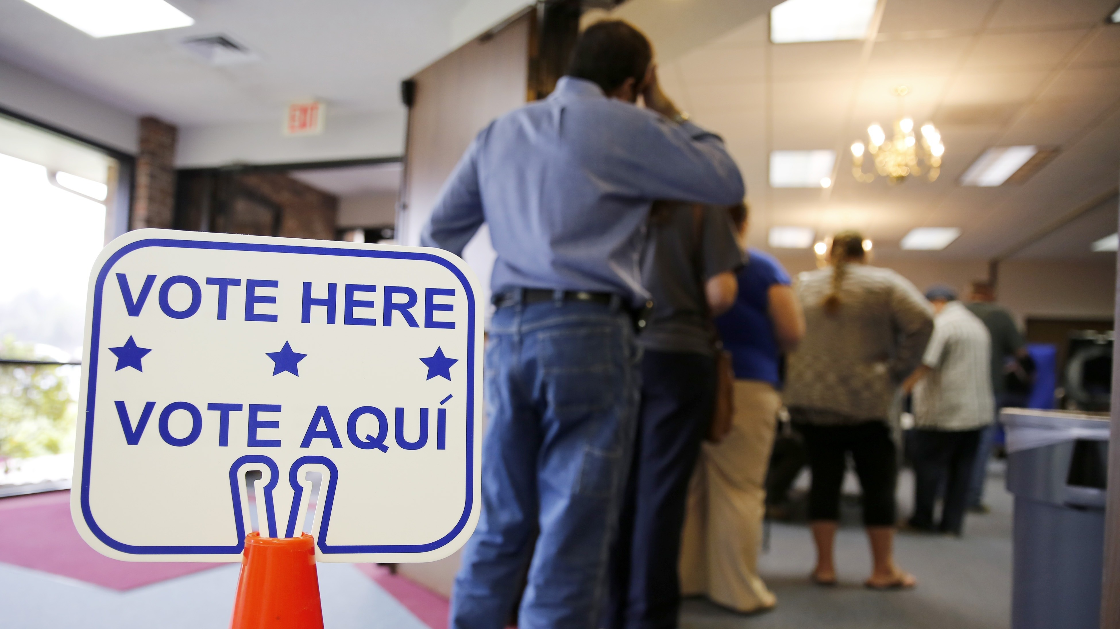 Voters stand in line to cast their ballots inside Calvary Baptist Church in Rosenberg, Texas, on March 1, during the primaries. (Photo by Erich Schlegel/Getty Images)