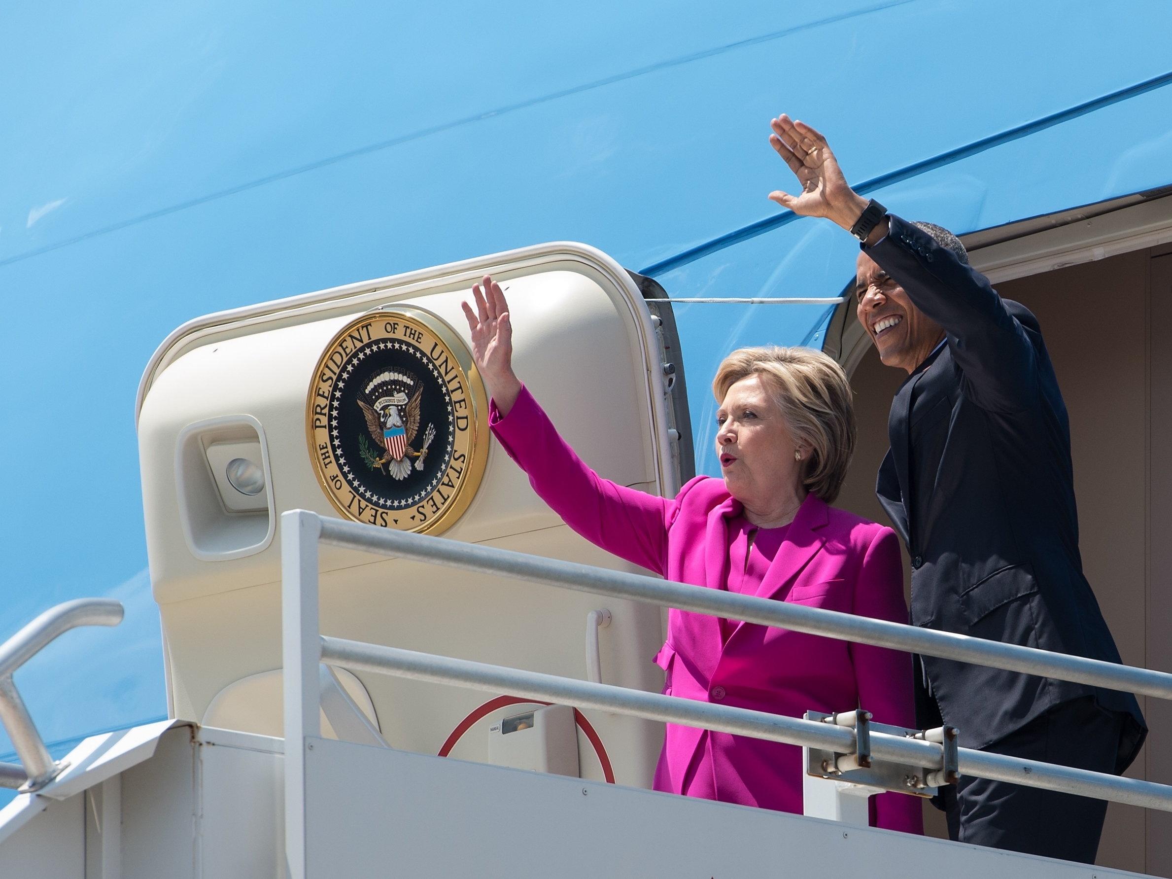 President Obama and Hillary Clinton walk off Air Force One in Charlotte, N.C., to attend a Clinton campaign event. The costs of that flight will be repaid by the Democratic National Committee. (Photo by Nicholas Kamm/AFP/Getty Images)