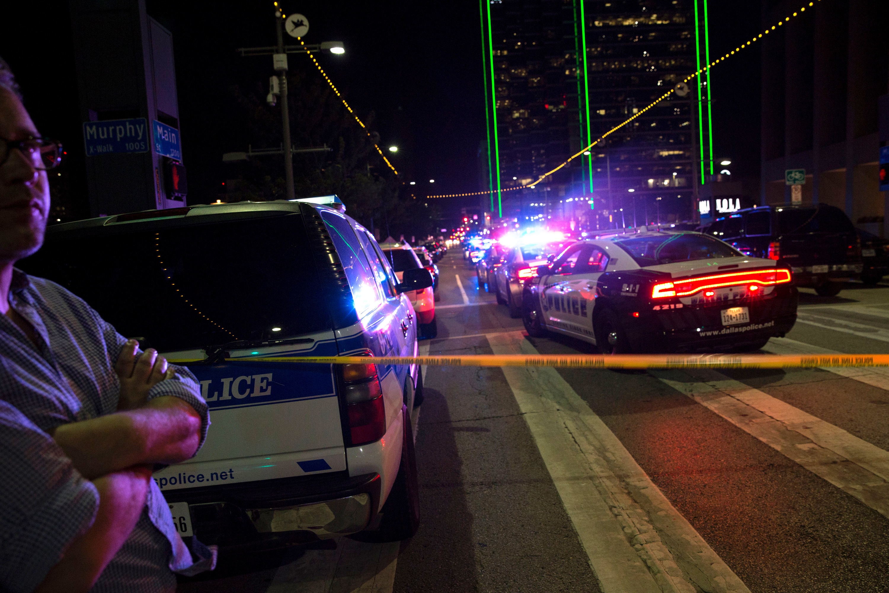 Police cars on Main Street in Dallas following the sniper shooting during a protest on Thursday. (Photo by Laura Buckman/AFP/Getty Images)