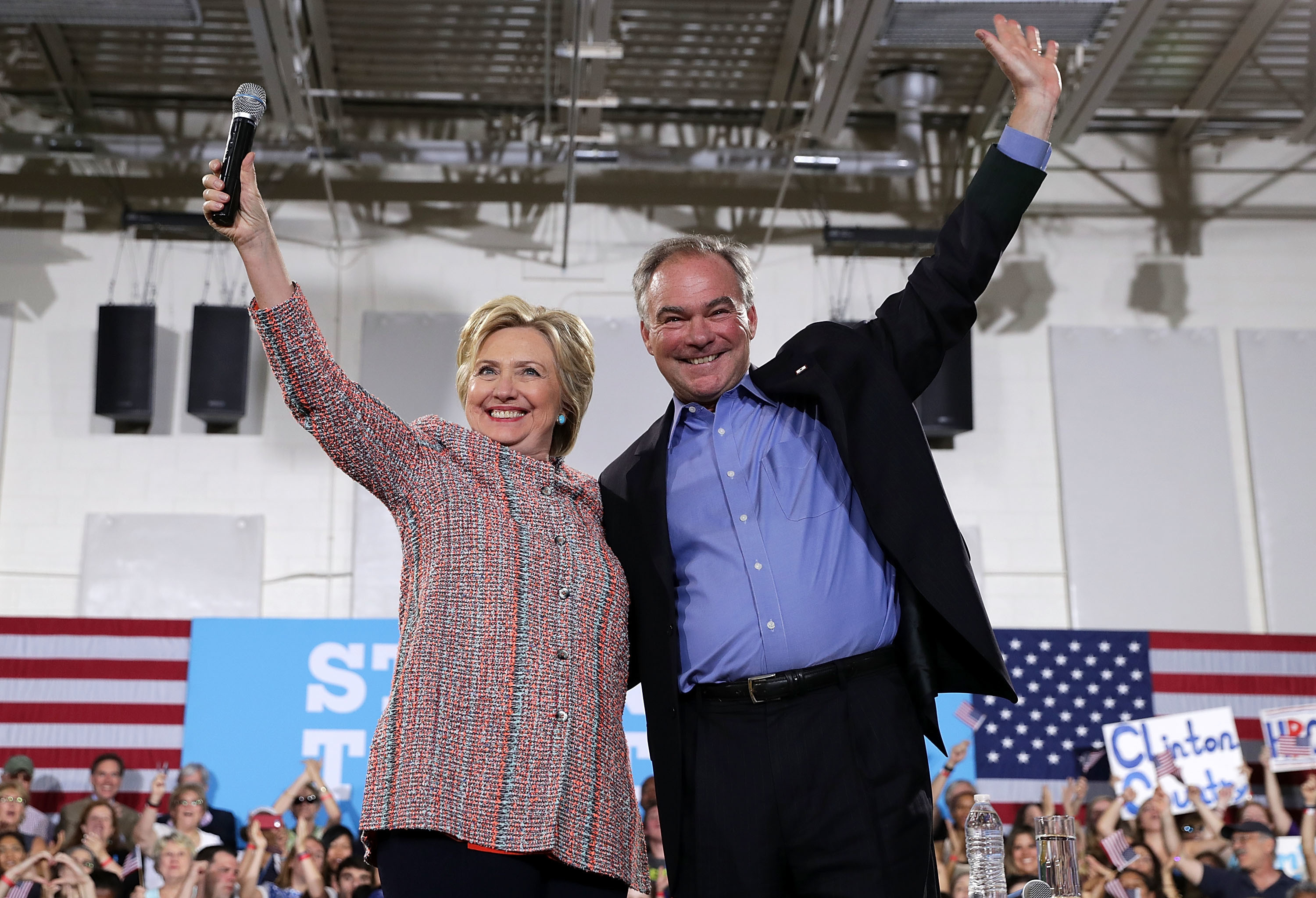Democratic presidential candidate Hillary Clinton and Sen. Tim Kaine of Virginia greet the crowd during a campaign event on July 14 in Annandale, Va. (Alex Wong/Getty Images)