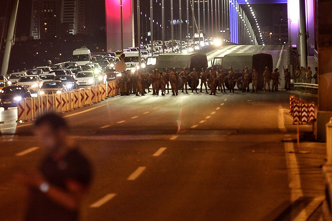 Turkish soldiers block Istanbul's Bosporus bridge on Friday while soldiers also occupied streets in the capital of Ankara. (Photo by Gokhan Tan/Getty Images)