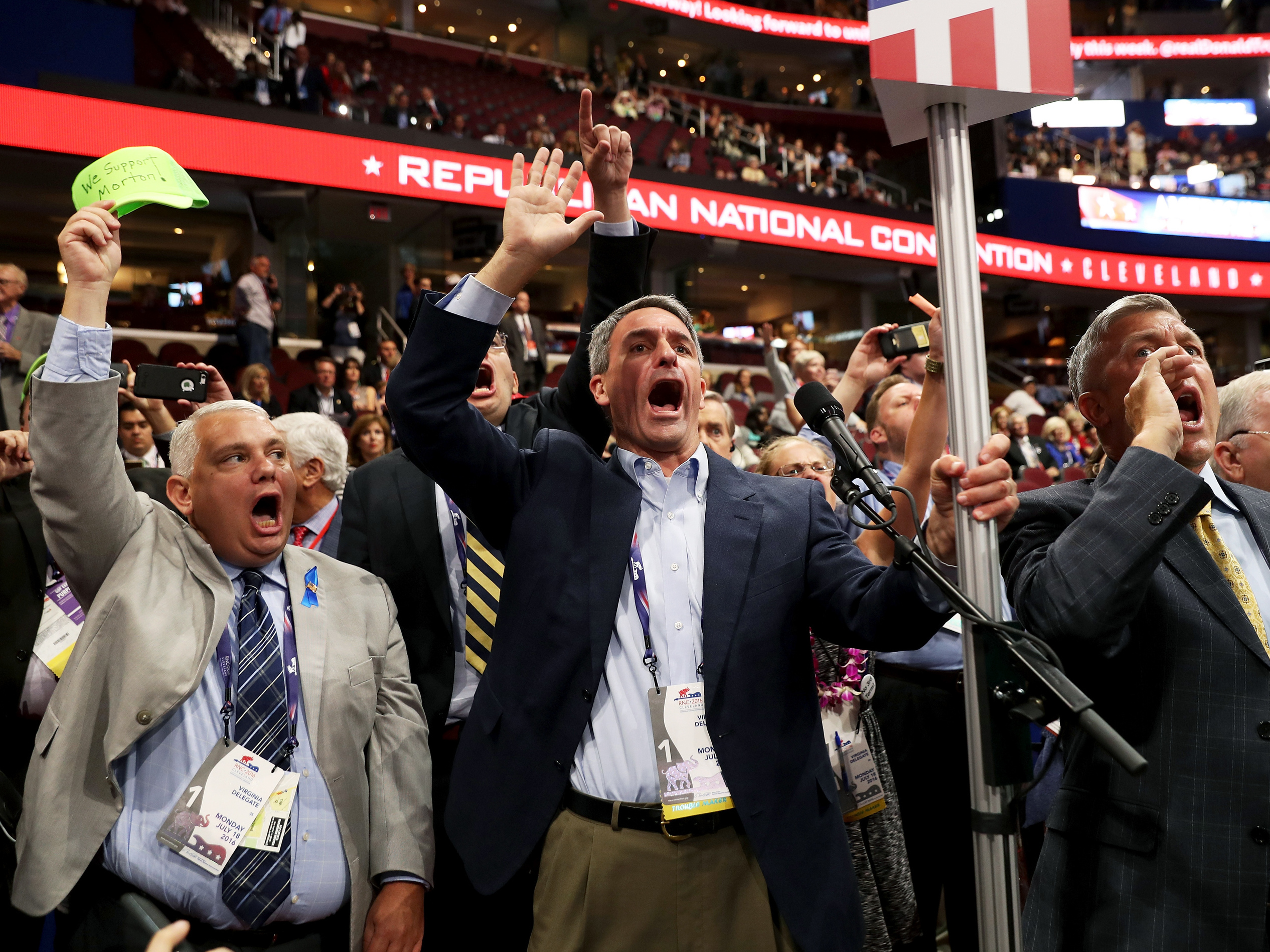 Former Virginia Attorney General Ken Cuccinelli (left) along with other delegates from Virginia chants for a roll call vote on Monday, the first day of the Republican National Convention, at the Quicken Loans Arena in Cleveland. (Photo by John Moore/Getty Images)