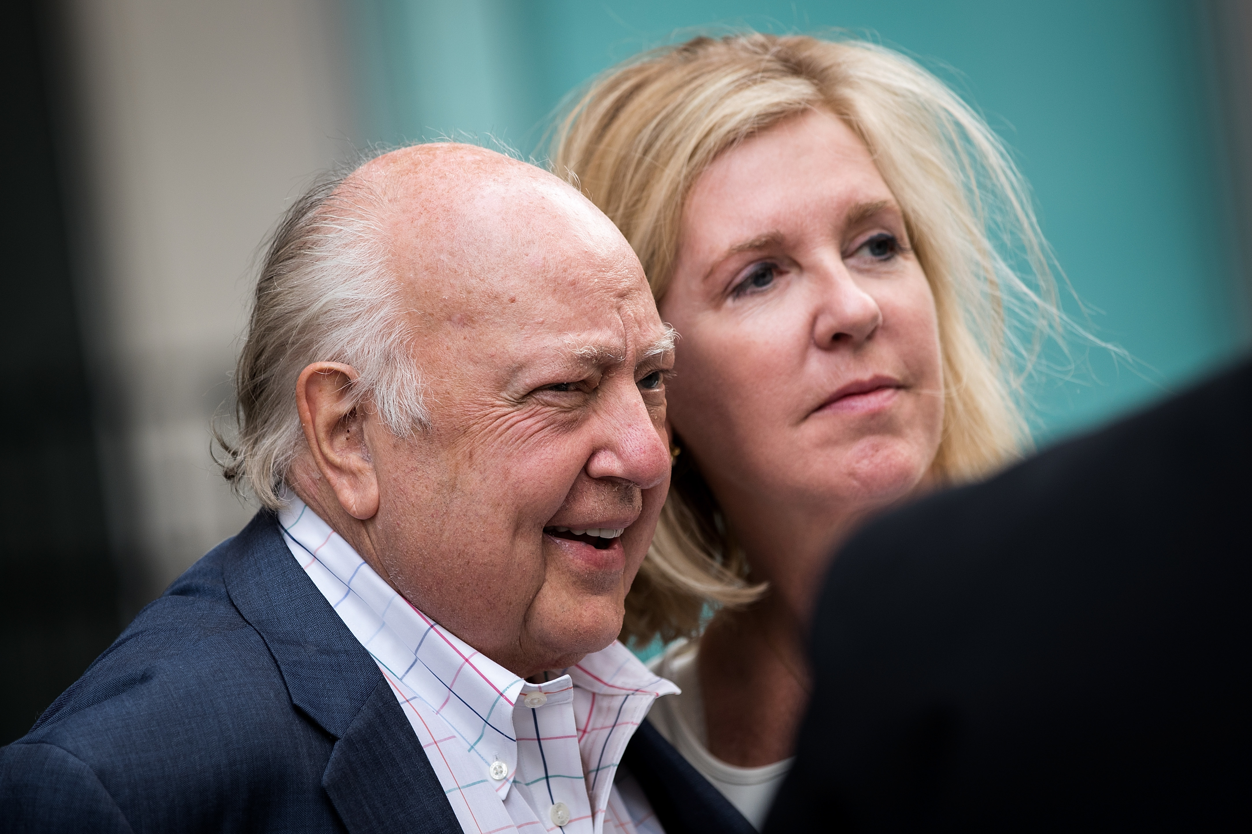 Fox News CEO and Chairman Roger Ailes and his wife, Elizabeth Tilson, leave the News Corp. building in New York on Tuesday. Ailes is stepping down from his role and Rupert Murdoch will be taking over as chairman and acting CEO. (Photo by Drew Angerer/Getty Images)