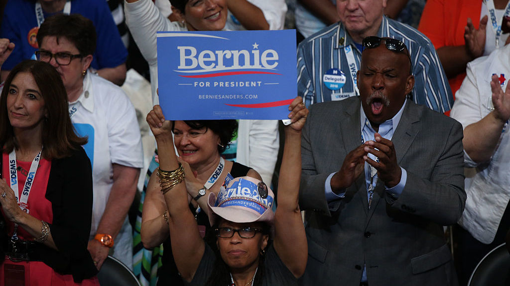 A delegate holds a campaign sign in support of Sen. Bernie Sanders, I-Vt., during the Democratic National Convention in Philadelphia.