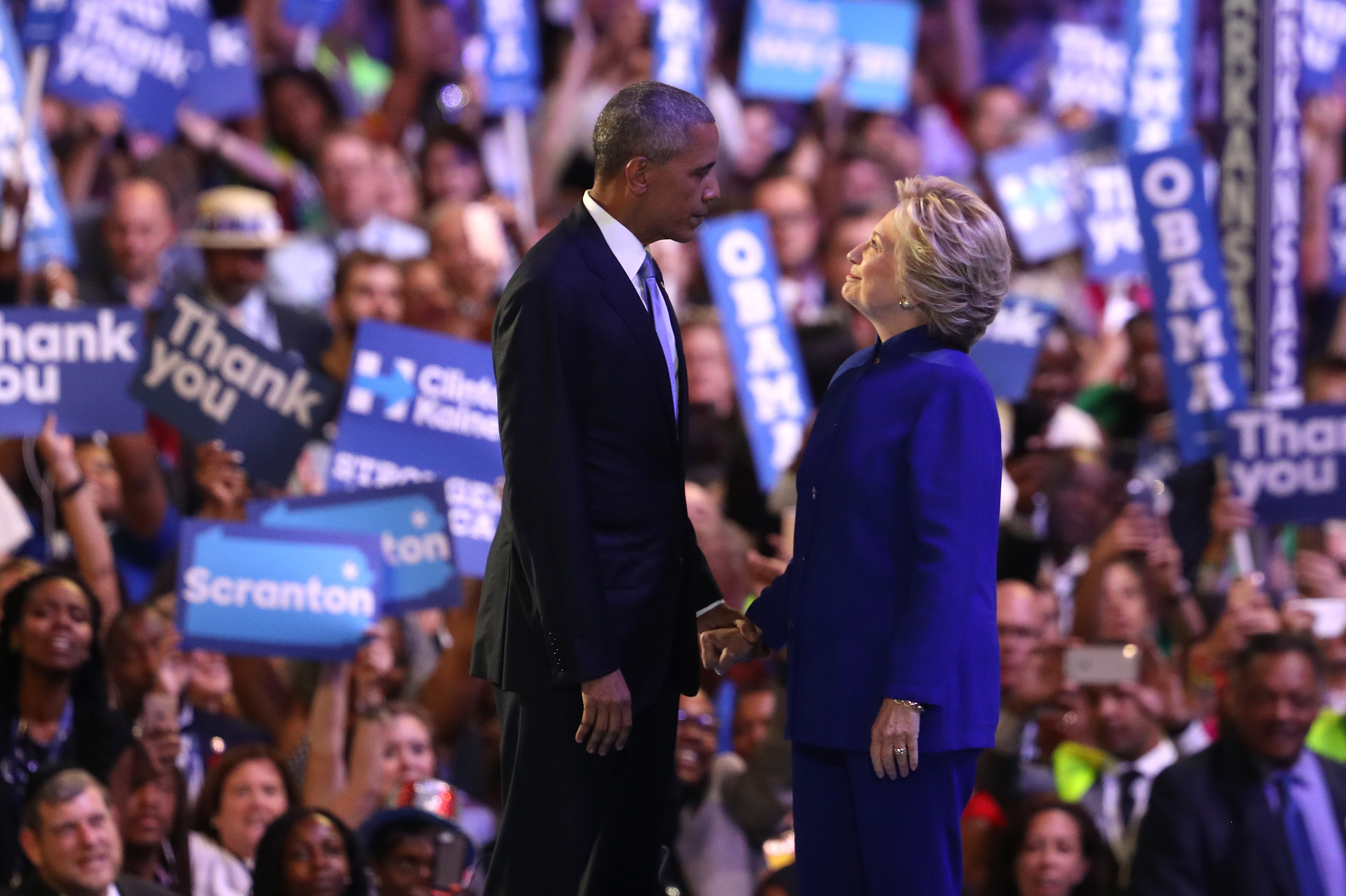 President Obama and Hillary Clinton stand together on stage on the third day of the Democratic National Convention in Philadelphia