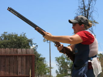 Kim Rhode takes practice shots with the assist of her father Richard Rhode, who's been her coach for 27 years. Nathan Rott