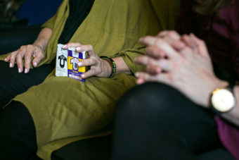 A woman lobbying Congress holds two versions of naloxone which can be used to reverse an opioid overdose. (Photo by Al Drago/CQ-Roll Call Inc.)
