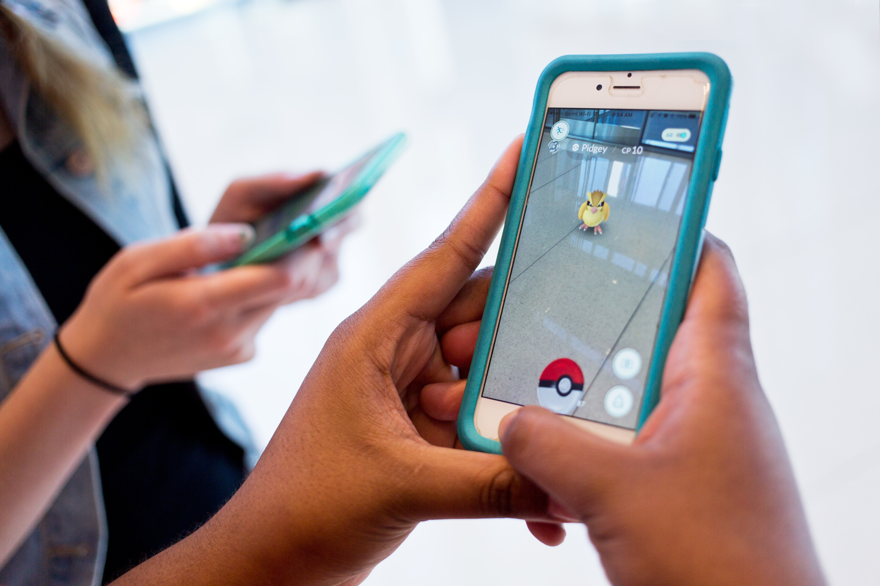 The mobile app Pokémon Go is currently the top downloaded free app in both Apple and Android stores. The augmented reality game allows smartphone users to track and catch Pokémon in real life. (Photo by Ruby Wallau/NPR)