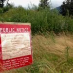 A sign advertising a public meeting marks the location of a planned senior housing building at Vintage Park in the Mendenhall Valley . (Photo by Ed Schoenfeld/CoastAlaska News)