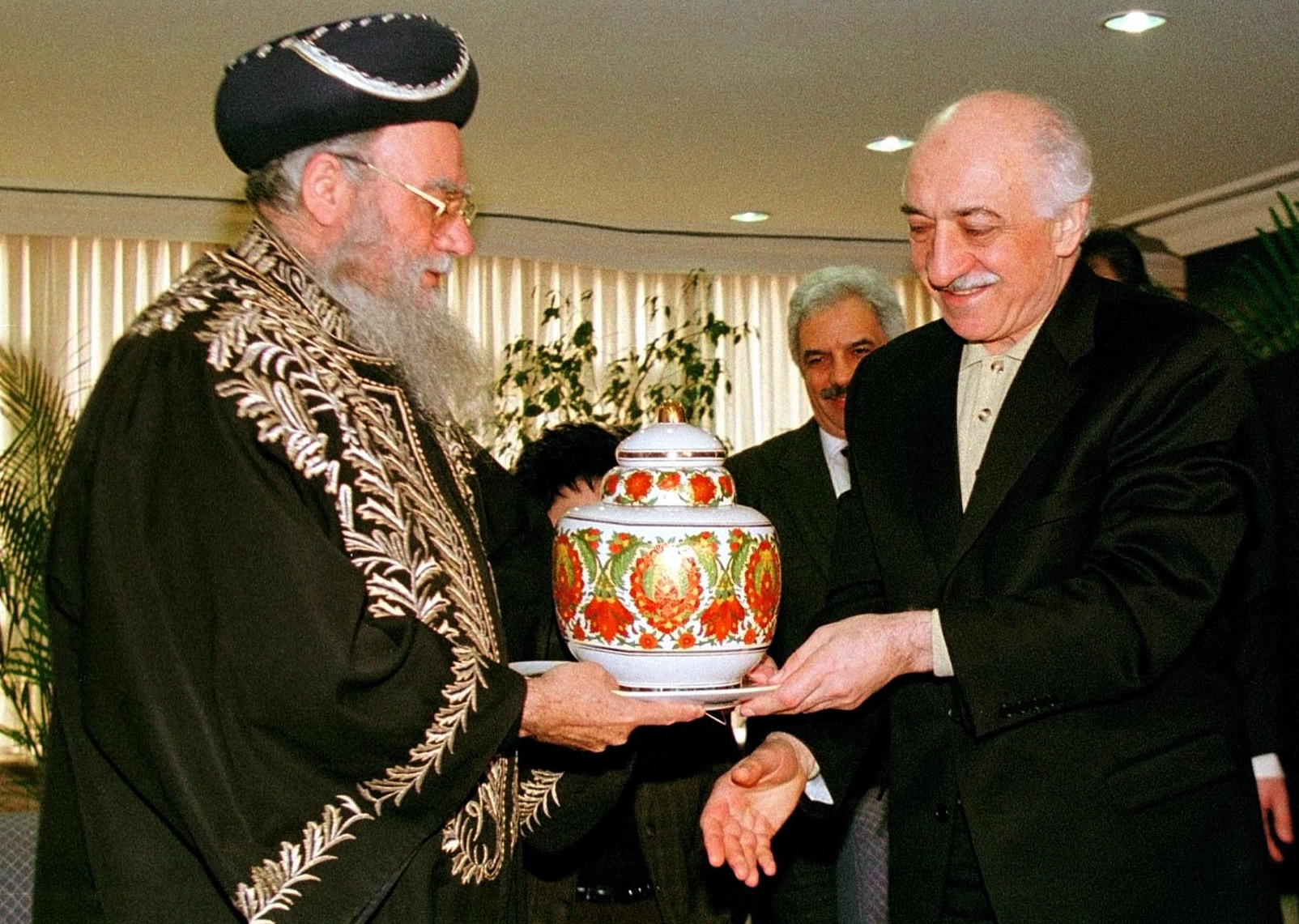 Muslim cleric Fetullah Gulen (right) receives a vase from Israel's Chief Rabbi Eliyahu Bakshi Doron during a meeting in Istanbul, Turkey, in 1998. Turkey's President Recep Tayyip Erdogan on Saturday accused Gulen of involvement in a coup attempt, a charge Gulen denied. MURAD SEZER/AP