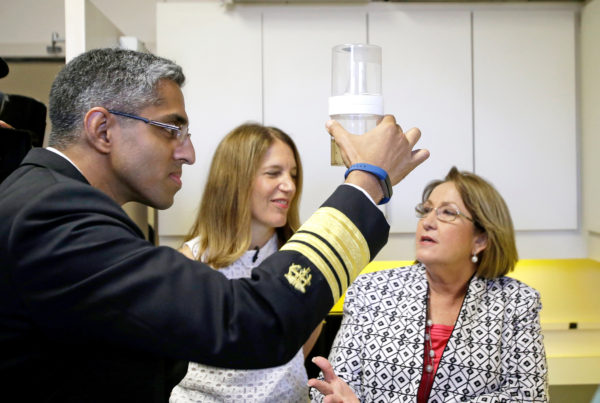 Surgeon General Vivek Murthy looks at a sample of mosquitoes in Orlando, Fla., on Monday. With him is Department of Health and Human Services Secretary Sylvia Burwell and Orange County Mayor Teresa Jacobs.