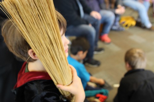 A young Harry Potter fan watches an improvised game of Quidditch at Sitka Public LIbrary. (Katherine Rose, KCAW)