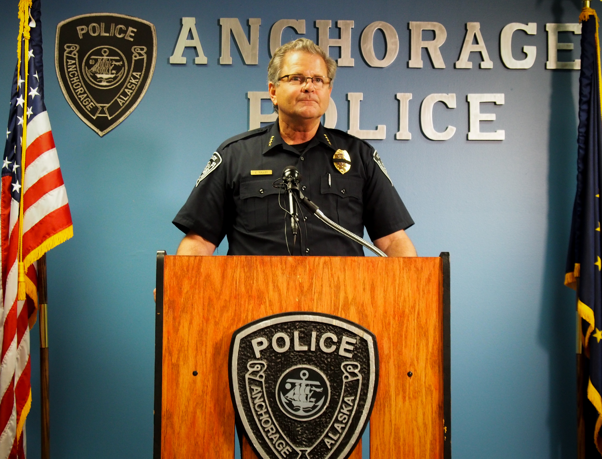 Anchorage Police Chief Chris Tolley addresses reporters during a brief press conference in July of 2016. (Photo by Zachariah Hughes/Alaska Public Media)