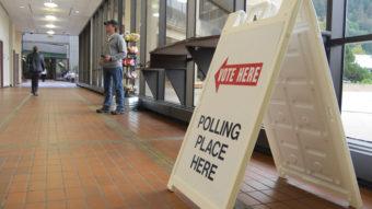 Vote here polling place placard