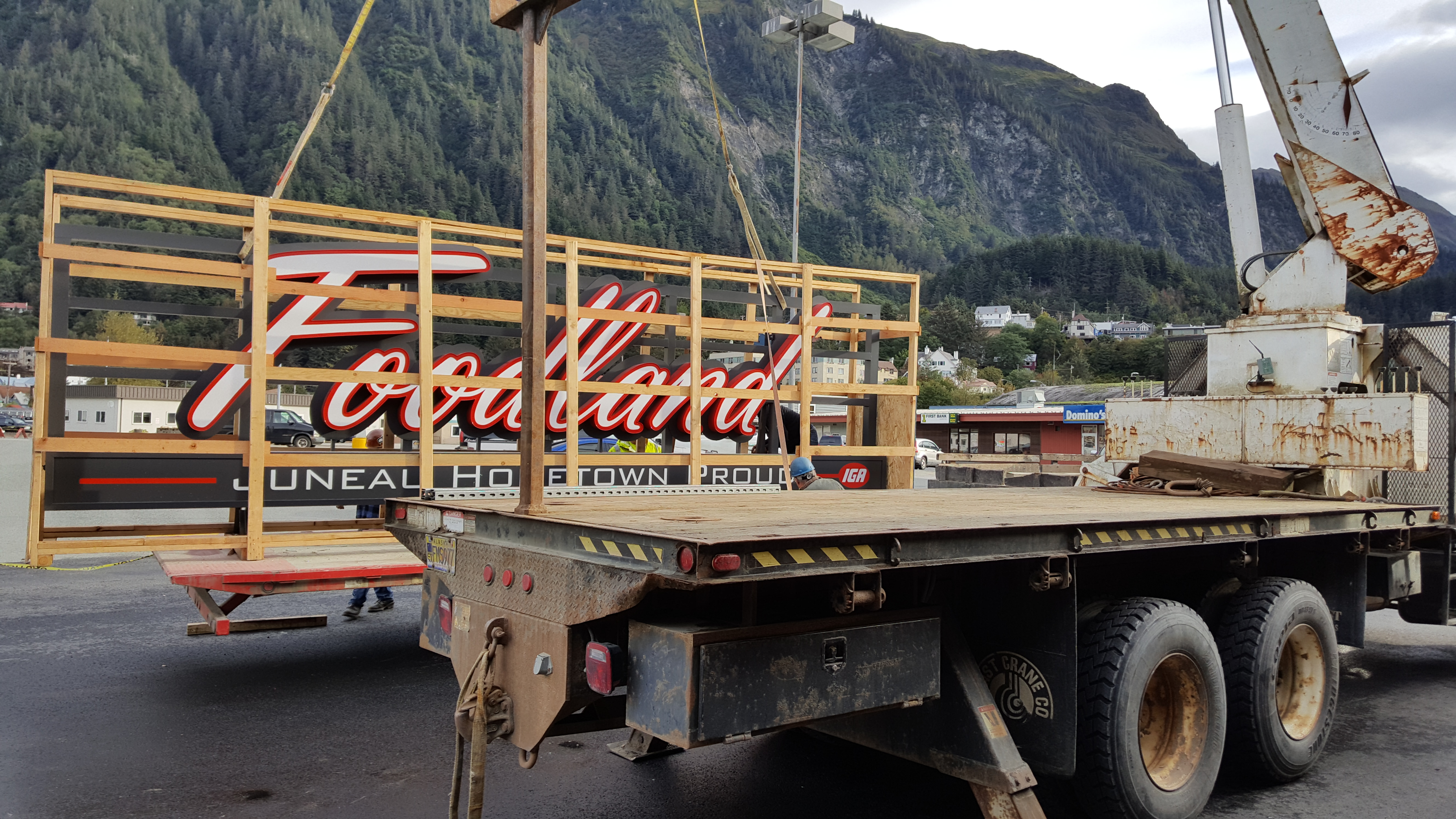 Workers from North Pacific Erectors Inc. of Douglas install a new sign at Foodland IGA in downtown Juneau. Store director Rick Wilson said the installation should be completed Tuesday afternoon. (Photo by Tripp J Crouse/KTOO)