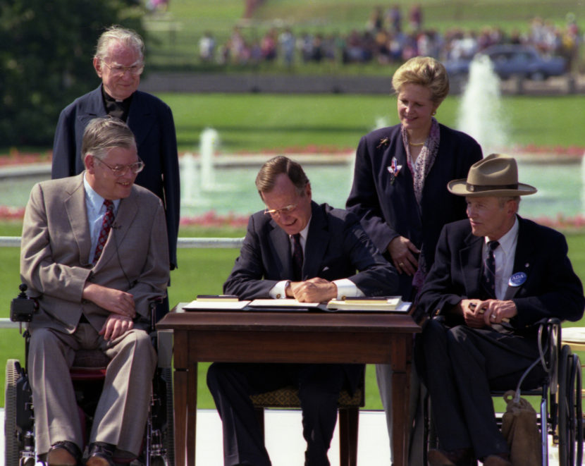 President George H.W. Bush signs Americans with Disabilities Act