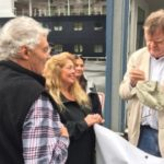 Retired A Prairie Home Companion host Garrison Keillor, right, signs autographs for fans while visiting Kodiak on August 24, 2016. (Photo by Jay Barrett/KMXT-Kodiak)