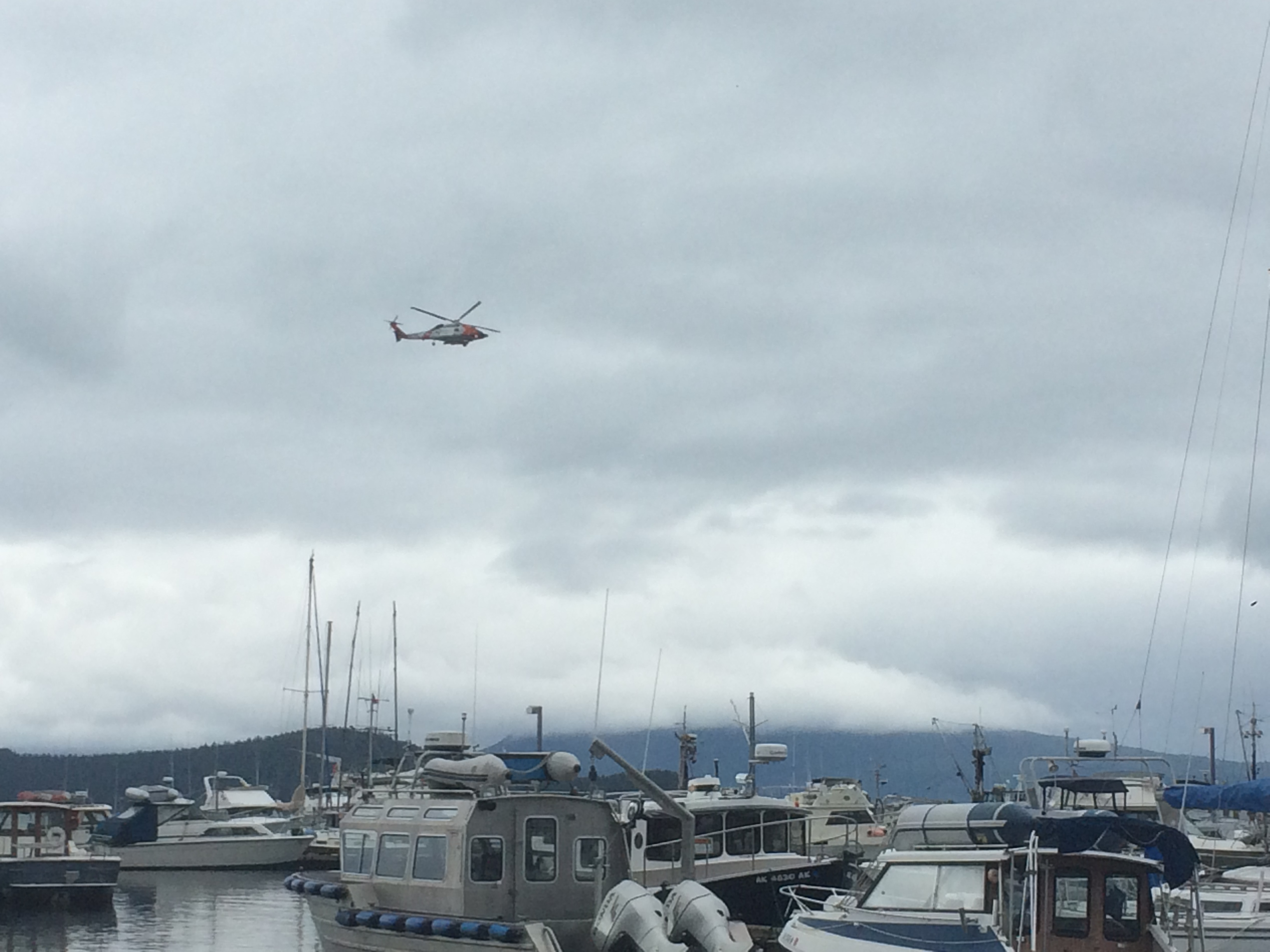 USCG helicopter flying near Don D. Statter Harbor in Auke Bay on Sunday, Aug. 14, 2016. (Photo by Quinton Chandler/KTOO)
