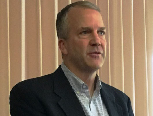 Sen Dan Sullivan, R-Alaska, speaks during a Ketchikan Chamber of Commerce lunch. (Photo by Leila Kheiry/KRBD)