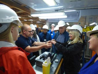 Governor Bill Walker and Donna Walker inspect a section of fiber optic cable aboard the vessel Ile de Sein. (Laura Kraegel, KUCB)