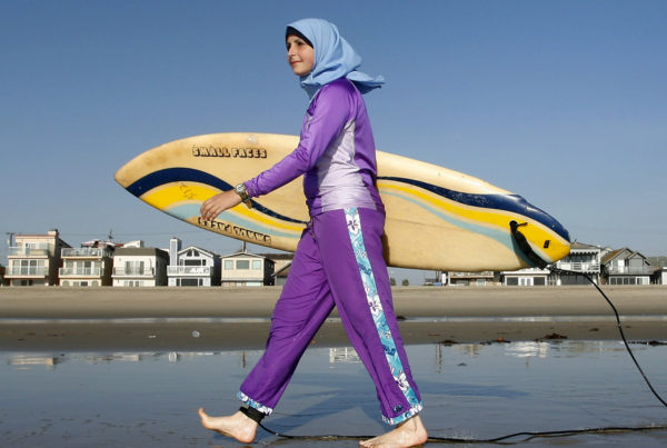 Sama Wareh walks along a California beach in swimwear designed for Muslim women. The photo is from 2007. (Chris Carlson/Associated Press)