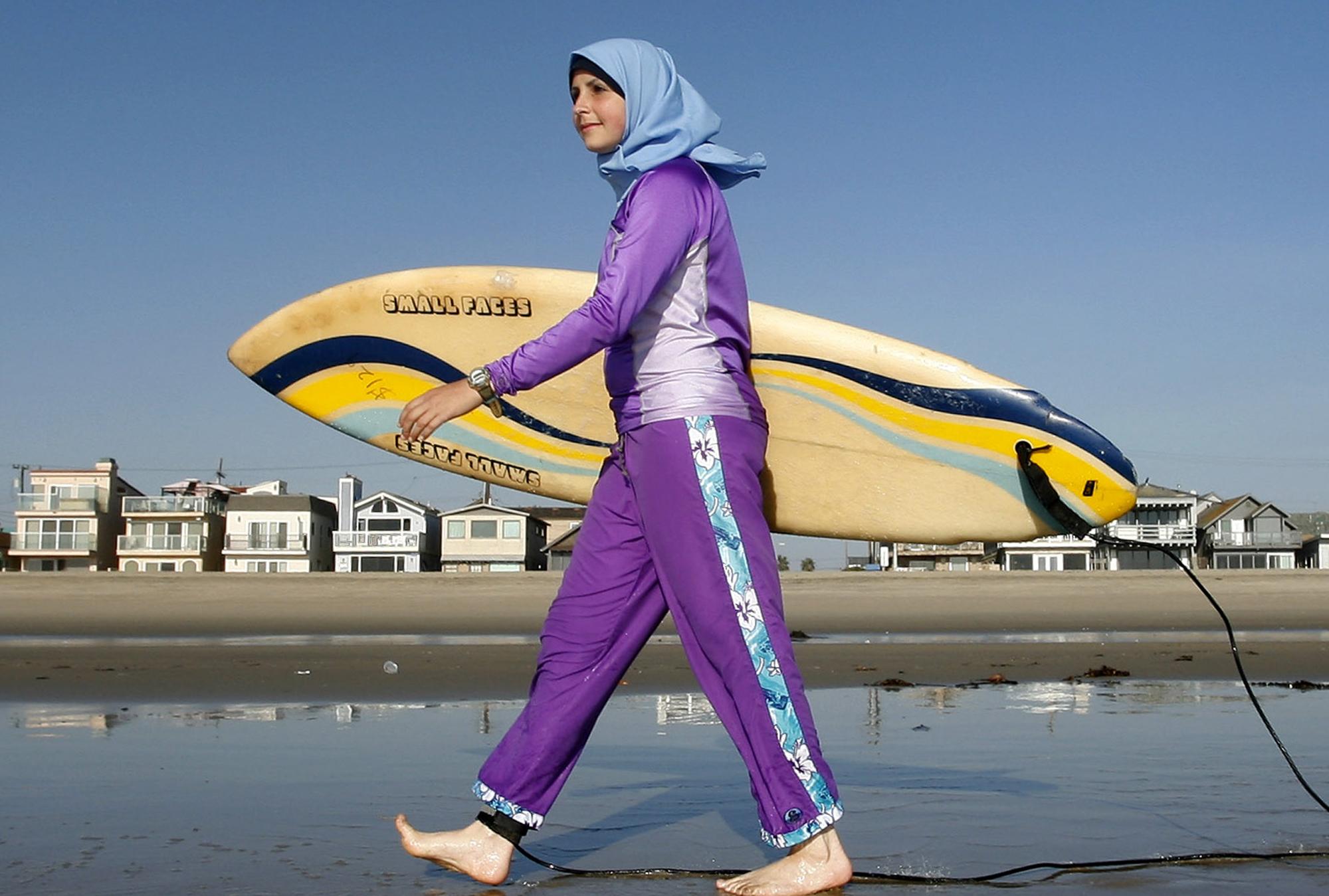 Sama Wareh walks along a California beach in swimwear designed for Muslim women. The photo is from 2007. (Chris Carlson/Associated Press)