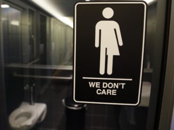 Signage outside a restroom at 21c Museum Hotel in Durham, N.C. A North Carolina law limiting bathroom choice for transgender people is being challenged in a federal court in Raleigh. Gerry Broome/AP