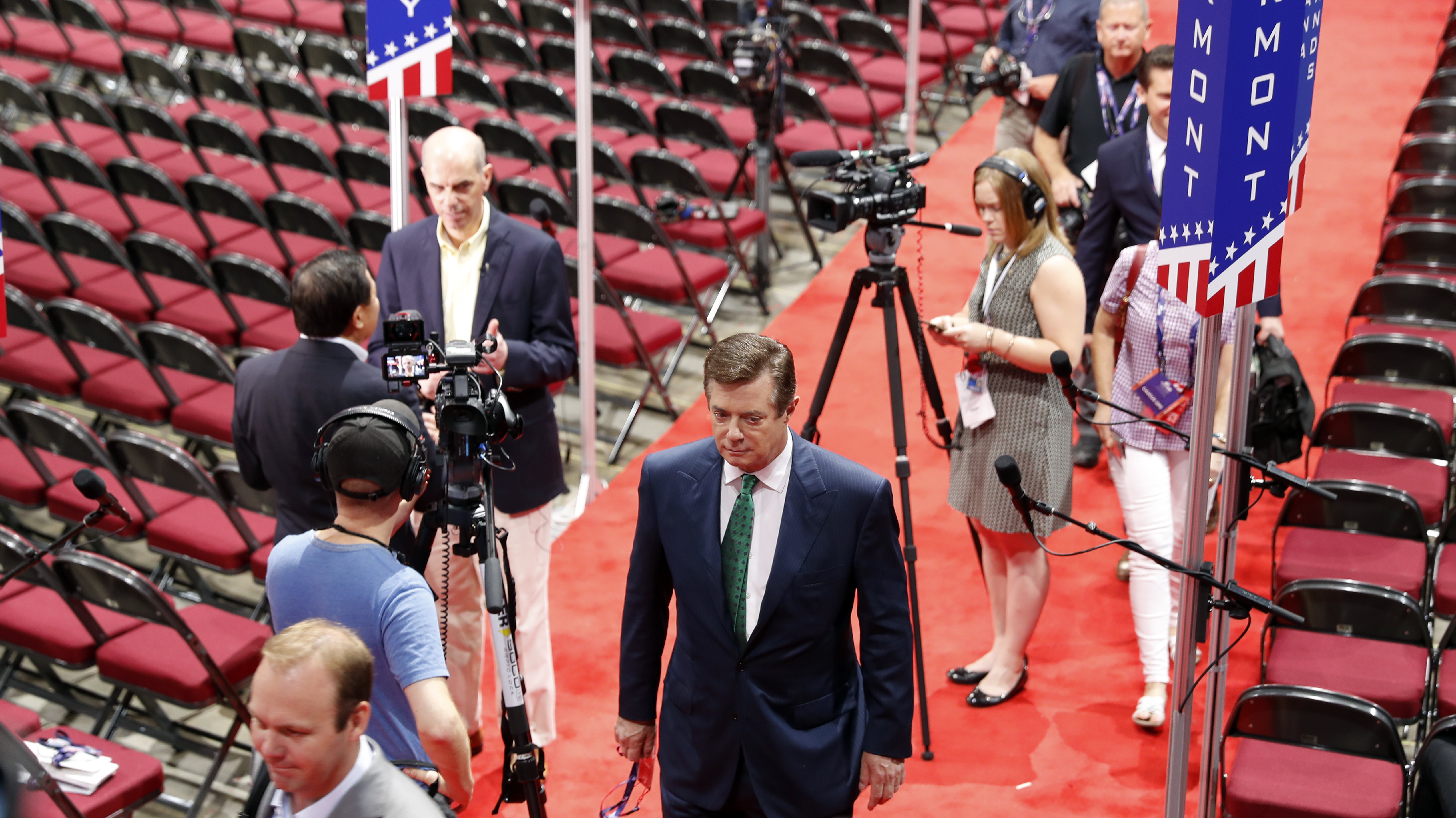 Trump campaign Chairman Paul Manafort walks off the floor of the Republican National Convention last month after talking to reporters. Photo by Carolyn Kaster/Associated Press)